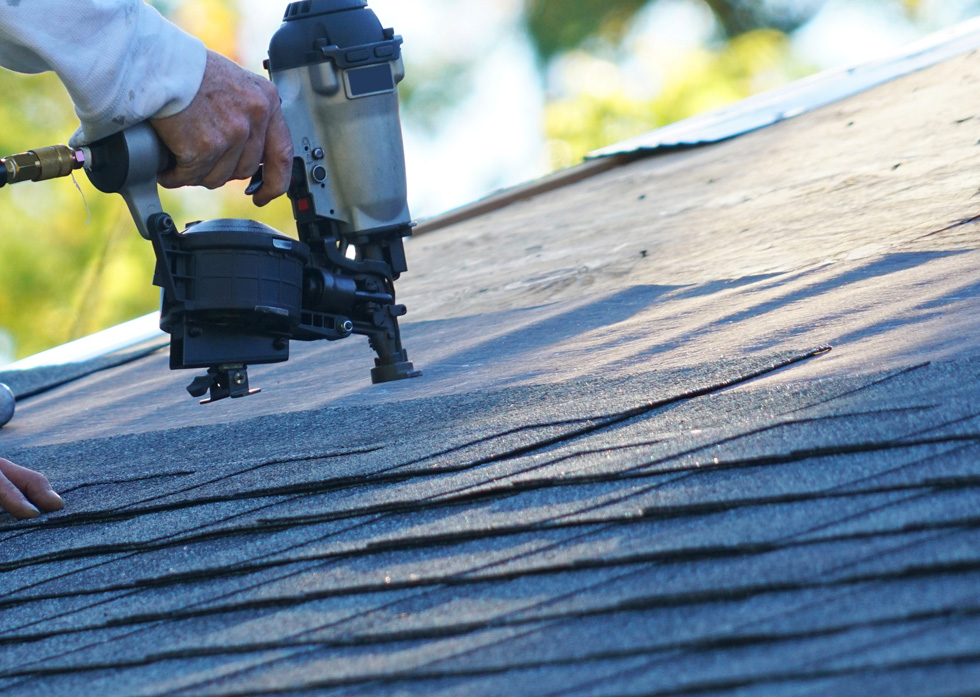 Professional roofing contractor replacing an old residential roof in Franklin, TN